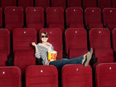 Smiling woman in 3D movie theater — Stock Photo