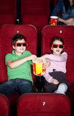 Children sharing popcorn — Stock Photo