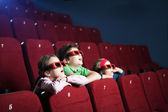 Excited kids in the movie theater — Stock Photo