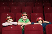 Surprised children at the cinema — Stock Photo