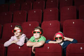 Friends in the movie theater — Stock Photo