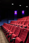 Red seats of cinema hall — Stock Photo