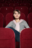 Attractive girl watching movies — Stock Photo