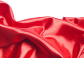 Red silk fabric over white background — Stock Photo
