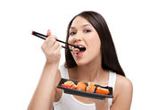 Attractive woman eating sushi — Stock Photo