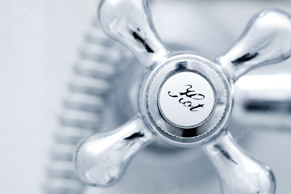 Bath tap with hot sign  close up  Stock Photo #10957945