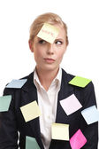Blonde businesswoman with colored stickers on her face — Stok fotoğraf