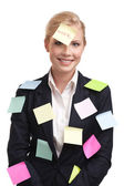 Attractive attractive businesswoman with colored stickers on her face — Stock Photo