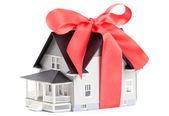 House architectural model with red bow — Stock Photo
