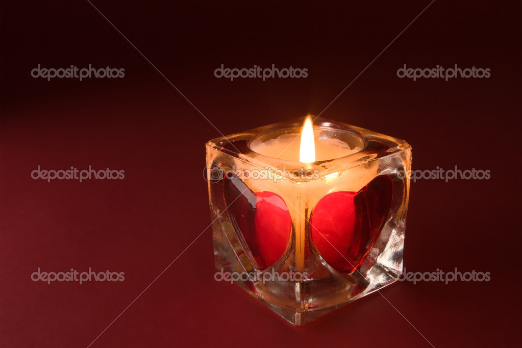 Beautiful candle with valentines on the red background — Stock Photo #10960466