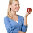 Smiling attractive woman holding red apple — Stock Photo #11063901