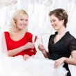 Two girls drink champagne or wine - Stok fotoğraf