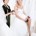 Future bride puts the garter — Stock Photo