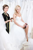Future bride puts the garter — Stock Photo