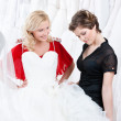 Thinking over a wedding gown — Stock Photo
