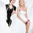 Shop assistant gives some piece of advice while future bride puts the garter — Stock Photo