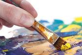 Somebody is painting something with paintbrush — Stock Photo