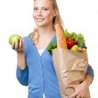 Young woman with a bag full of healthy eating — Stock Photo #11784723