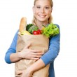Beautiful woman with a bag full of healthy eating — Stock Photo #11784725