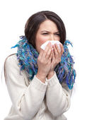 A cold beautiful woman holding wipe — Stock Photo
