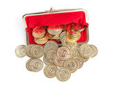 Scattered silver and gold coins are in red purse, isolated on white background — Stockfoto