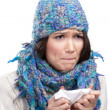 Stock Photo: Cold young womholding wipe