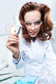 Dentist's assistant is ready to help him — Stock Photo
