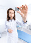Dentist's assistant examines the x ray image, distorted — Stock Photo