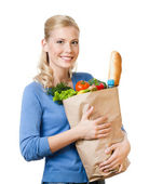 Pretty woman with a bag full of healthy eating — Stock Photo