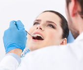 Dentist examines teeth of the patient — Stock Photo