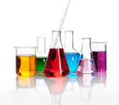 Various laboratory flasks with a colored liqiuds — Stockfoto