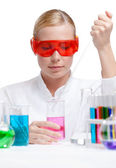 Investigator tests purple liquid in beaker — Stock Photo