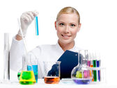 Medic researcher holds vial full of blue liquid — Stock Photo