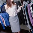 Choosing clothes at the store — Stock Photo