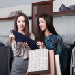 Two girlfriends go shopping — Stock Photo