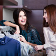 Friends do shopping at the store with great choice of clothes — Stock Photo #12160213