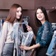 Friends do shopping and discuss a dress — Stock Photo #12160219