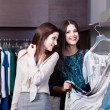 Women want to try on a dress — Stock Photo #12160266