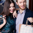 Wonderful couple is in the shopping mall — Stock Photo