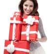 Pretty woman holds many presents — Stock Photo