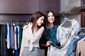 Women want to try on a dress — Stock Photo