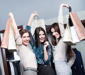 Three friends after shopping — Stock Photo