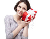 Listening to the present wrapped in red paper — Stock Photo