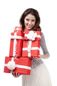 Pretty woman holds many presents — Stockfoto