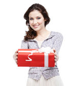 Young woman proffers a gift — Stock Photo