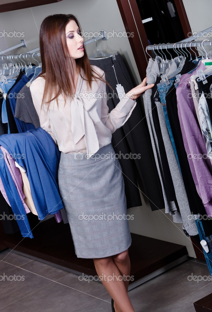 Young woman chooses clothes at the store — Stock Photo #12160128