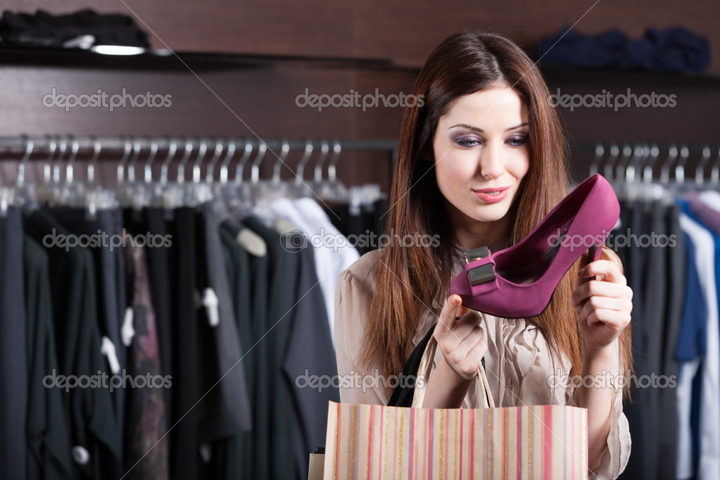 Woman stares at excellent fuchsia shoes at shopping center  Stock Photo #12160138