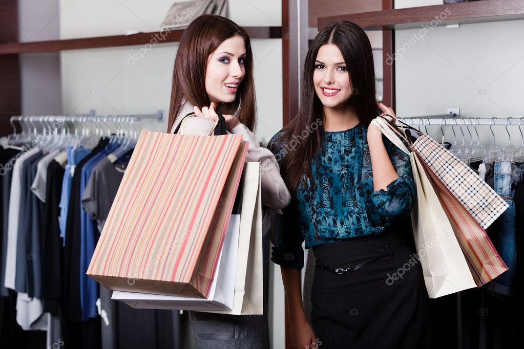 Two friends are in the store with grate sales — Stock Photo #12160171