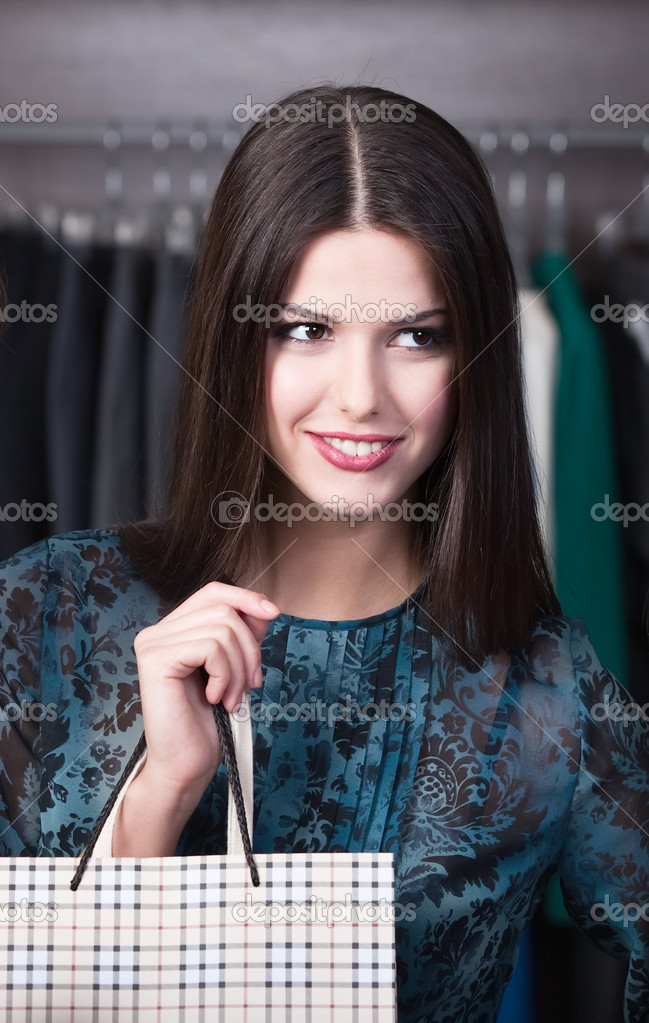 Beautiful customer is in the shop — Stock Photo #12160290