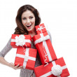 Woman hands a number of gift boxes with white ribbons — Stock Photo